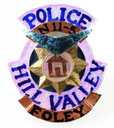 Lot #80 - BACK TO THE FUTURE PART II (1989) - Officer Foley's (Stephanie E. Williams) Hill Valley 2015 Police Department Badge