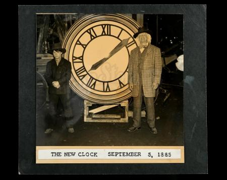 Lot #93 - BACK TO THE FUTURE PART III (1990) - Marty McFly (Michael J. Fox) and Doc Brown (Christopher Lloyd) New Clock Photograph