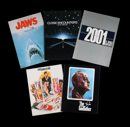 Lot #101 - 2001: A SPACE ODYSSEY (1968), JAWS (1975), CLOSE ENCOUNTERS OF THE THIRD KIND (1977), THE GODFATHER (1972), LIVE AND LET DIE (1973) - Group of Five British Souvenir Brochures, 1968 to 1977