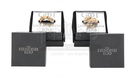 Lot #279 - GAME OF THRONES (TV SERIES, 2011-2019) - Two Gold Cast and Crew Gift Dragon and Direwolf Rings