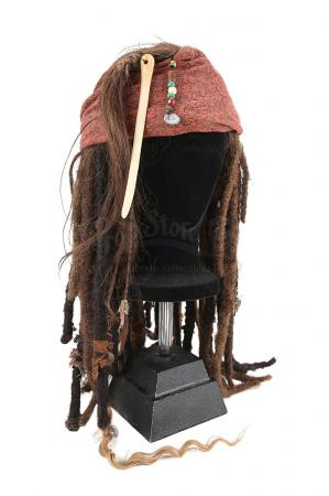 Lot #553 - PIRATES OF THE CARIBBEAN SERIES (2003-2017) - Captain Jack Sparrow's (Johnny Depp) and Angelica's (Penelope Cruz) Wig and Bandana