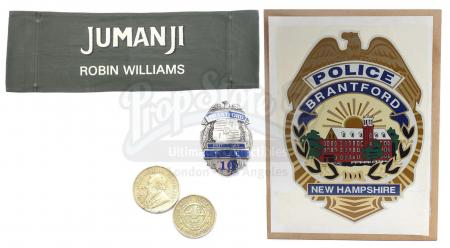 Lot #430 - JUMANJI (1995) - Van Pelt's (Jonathan Hyde) Gold Coins, Robin Wiliams Chairback, Police Badge and Police Car Decal